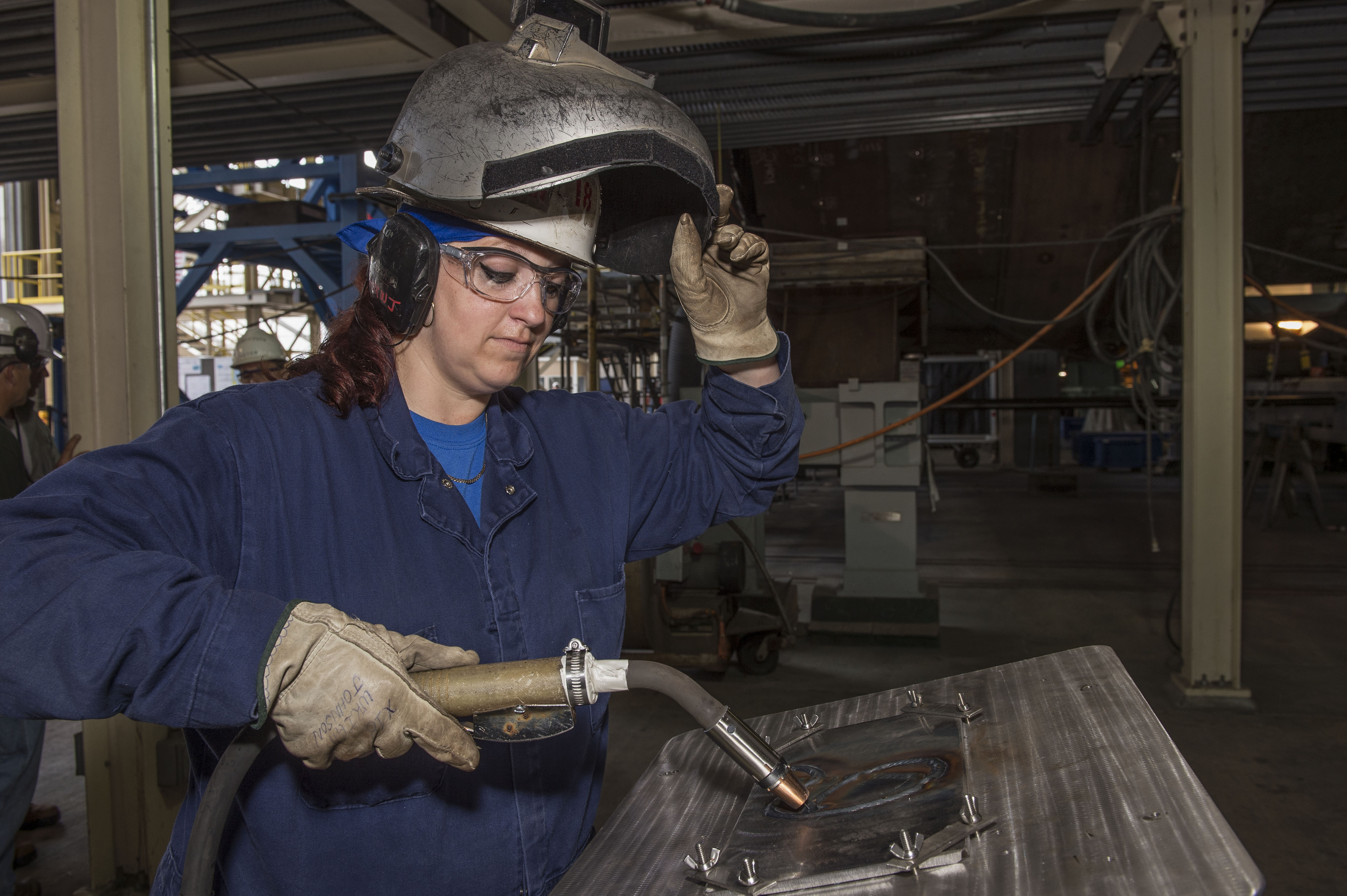 Heather Johnson welder for Indiana Keel Laying. Heather is the first female welder to weld the initals of a ships's sponsor on a Virginia-class submarine.